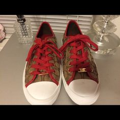 BN Rare Beautiful Coach Sneakers!! COACH signature sneakers w/ Red laces and beautiful gold trim on these babies!! As stated, BN never worn, Authentic. Coach Shoes Sneakers