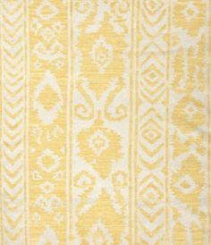 World Market yellow tribal rug