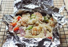 Cajun hobo packets | A Beautiful Mess - I am so going to try this with some catfish. I guess if you're really going camping, cook the rice beforehand and pack it along in a tupperware in the cooler with everything else.