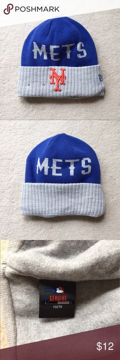 New Era Youth Winter Mets Beanie Show your team spirit all year! This Mets hat by New Era is officially licensed. It says Mets on the front and back with an embroidered Mets logo on the front. It is fully lined. New Era Accessories Hats
