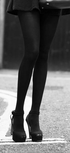 black tights - and I love how this pic pairs them with black heels and a black mini. I wear black tights with everything from denim to suits.