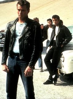 The T-Birds are the gang from the movie Grease.  Danny Zuko (Travolta) is the leader of the T-Birds because of his quick thinking and charming personality.  Zuko can handle any social group, and even the group of girls.  While other members of the T-Birds struggle with their encounters with females, such as Kenickie and Rizzo, Danny ultimately succeeds with Sandy because of these leadership skills.  The reversal in this case is that Sandy is the newcomer who eventually leads the Pink Ladies.