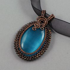Copper and Blue Glass Cat's Eye Necklace by sylva on DeviantArt