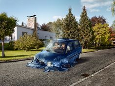 surreal scenes show melting cars disappear into suburban streets