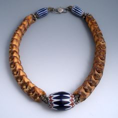Designer Unknown |  Three Venetian Chevron glass beads from the African trade are combined with old Snake Vertebrae beads and heavy old accent Bali beads