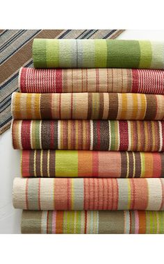 Reversible handwoven cotton rugs add a burst of brilliance to casual cottage decor. Made to mix and match in five distinctive striped patterns. Comes in 6 rectangular sizes, including runner. Colors: Tortola, Saranac, Nantucket, Framboise or Caravan. Fabric Rug, Woven Fabric, Baby Play Areas, Lace Bedding, Craft Stalls, Dash And Albert, Striped Rug, Weaving Patterns, Design Theory