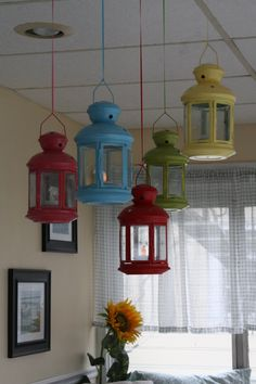 Colorful lanterns on the front porch. Maybe Teal, Red, Yellow