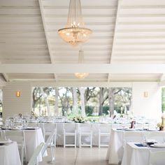 Modern White Reception Decor // photo by: Caroline Joy // http://www.theknot.com/weddings/album/a-casual-southern-wedding-in-austin-tx-137223