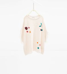 Embroidered floral poncho
