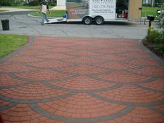 Stamped asphalt is a decorative option that allows regular asphalt to be transformed into authentic looking brick, stone, or slate. Stamped asphalt by Integrated Paving Concepts can be seen at Time… Concrete Driveways, Concrete Wood, Walkways, Cobblestone Patio, Pavement Design, Paver Blocks, Paving Pattern, Paver Designs, Asphalt Driveway