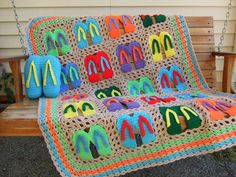 Don't you love flip flops? This is a great way to use up all of those little balls of yarn. Each flip flop square is made individually from worsted weight yarn and then sewn together. It is such a light, colorful afghan and would look so pretty on a covered porch or thrown over a chair for summertime. If you have a friend of family member that loves flip flops, this will make a wonderful gift that will last a long time. Pattern pack also include instructions for a flip flop pillow!!!!