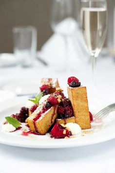 Brioche French Toast (assorted berries, home made maple marmalade, whipped crème fraiche.)