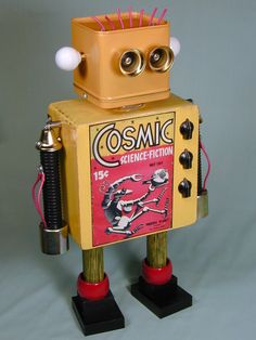 """COSMIC"" Found Object Robot Sculpture Assemblage    Approximately 19"" tall. Made by Sally Colby. Signed. Made almost entirely of recycled, vintage, and found objects. Parts include a cigar box, vintage radio knobs, metal bells, furniture knobs, electronic bits and more."