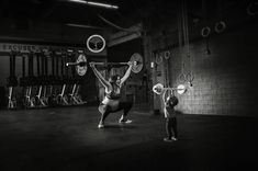 Inspiring photos of badass expectant mom Lauren Ferris, showing off her CrossFit skills at 35 weeks pregnant. Photo by JoAnn Marrero @fromlabortolove.