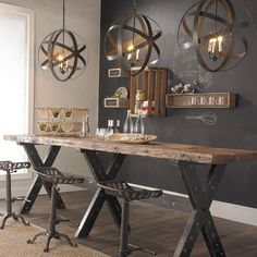 Cool rustic industrial space with tractor stools and metal orb lanterns