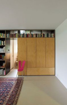 Sydney architect Anthony Gill has cleverly hidden a murphy bed in this wall of cabinets