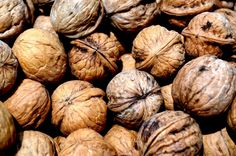 Walnuts in the shell photographed by Peter Griffin. PulbicDomainPictures.net