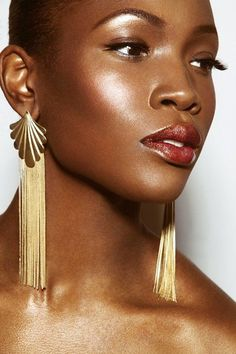 I love everything about this. Her lip color-need it, her cheek color-gorgeous, and her skin is flawless. AT