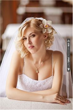 I've decided this is how I want my hair: wavy and down with a flower and my veil. :)