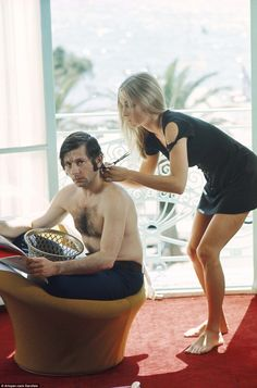 A 1968 picture shows Sharon Tate giving actor, director and husband Roman Polanski a hair trim..