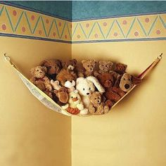 A toy hammock stores and displays kids' stuffed animals nicely. This one comes as a set of two for just $15.99 from StacksandStacks.com | thisoldhouse.com