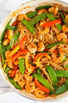 GINGER GARLIC SHRIMP NOODLE STIR FRY An easy and flavorful weeknight dish to satisfy your stir fry craving! This ginger garlic shrimp noodle stir fry is packed with everything your tastebuds will love and they'll love you back! Shrimp Noodle Stir Fry, Shrimp Rice Noodles, Shrimp And Rice, Asian Noodles, Asian Recipes, Healthy Recipes, Ethnic Recipes, Stir Fry Recipes, Cooking Recipes