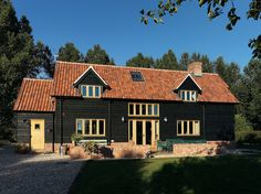 Border Oak - barn with black stained weatherboarding.