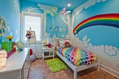 We think kids' rooms look best when bright and bold colors are used in the decor. And, what better way to show bold color than with rainbow kids room decor! Rainbow Room Kids, Rainbow Bedroom, Rainbow Theme, Rainbow Bedding, Bedroom Themes, Girls Bedroom, Bedroom Decor, Bedroom Ideas, Bedroom Wall