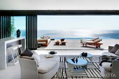 Dramatic volumes, softened by curves, spaces that seem to float on air, spectacular views matched by privacy and intimacy. Energy and luxury.  A relaxed ambiance built with high end finishes. A dream space with dream views. An amazing multi level house perched on the side of Lion's Head in Cape Town, South Africa. By SAOTA - Stefan Antoni Olmesdahl Truen Architects and interior design by OKHA Interiors.