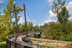 Neuse River Greenway Trail 12098 New Falls of Neuse Road, Wake Forest, NC 27587 Wake Forest Nc, Concrete Deck, Steel Bridge, Tens Place, River Trail, Ends Of The Earth, Bridge Design, Pedestrian Bridge, Suspension Bridge