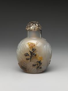 Snuff Bottle with Birds and Flowers Period: Qing dynasty (1644–1911) Date: late 18th–early 19th century Culture: China Medium: Chalcedony with silver stopper