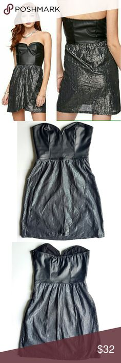 """Hurley Faux Leather Strapless Dress Sexy night out! Faux leather top and shimmer skirt. Lined, side zipper, elastic band in the back for better grip.  14.5"""" across chest,  12"""" waist,  26"""" total length.  In excellent condition. Hurley Dresses Mini"""
