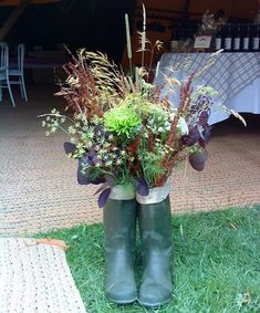 Flowers in boots make a novel decoration in keeping with our rural country feel