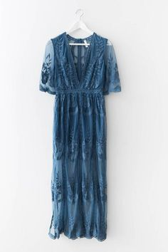 Gorgeousembroidered lace maxi dress Plunging V neckline Scalloped trim Side slits Zipper back Non-stretch lace Lined neckline and shorts underneath 100% Polye