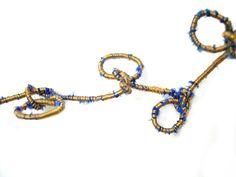 Tanvi Kant - Blue, green and gold 'Knotted Loops' wrap necklace detail