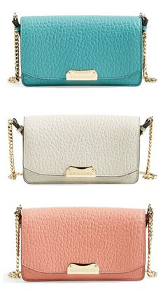 Trying to decide between aqua blue, stone white or pastel pink   Burberry 'Madison' leather wallet on a chain.