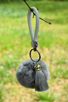 Rabbit Fur Ball Keychain, Hand Back, Backpack, and more, Silver Fur by ZEnella on Etsy https://www.etsy.com/listing/275697020/rabbit-fur-ball-keychain-hand-back