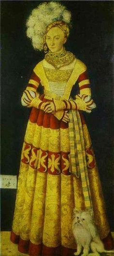 "This painting is from a german noble woman with her little maltese painted by Cranach the Older in the middle ages, end of the 14th century. There is still the typical stiffness of the painted characters to observe which is overcome in the renaissance a little later on. The little Jewel suffers a little from this rigid expression same as his Mom :-) Again, we see its coat cut in the then fashionable ""Lioncut"" :-)"