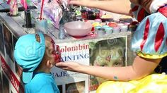 Video about Artist paints on children s faces. Video of childhood, event, child - 77397623