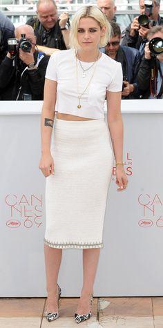 Kirsten Stewart in a crop top and tweed Chanel pencil skirt.