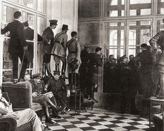 Paris Peace Conference: Aides stood on chairs to watch as the Treaty was signed in the Hall of Mirrors in the Palace of Versailles, June 28th, 1919.