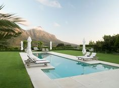 Table mountain, Cape Town- poolside and lawn- Franchesca Watson | Garden Designer