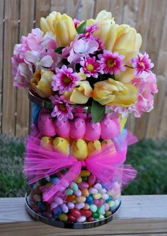Cute idea i have made so many of these at work the are so fun to make all you need is a double vase and the supplies put the flowers in the center and WALA!