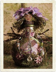 Zinny    Altered art bottle doll I created for an online class I taught last year. Lots of fun to do.. If you would like to learn how to make this style of doll, the tutorial will soon be available on my website. I am also going to post them on my Etsy, Artfire and HandMadeArtists shops. Just look for wingsnscales! I have video and pdf files included in the tutorial.    Chris
