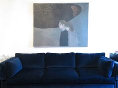 I just love how one giant piece of art looks over the navy sofa.