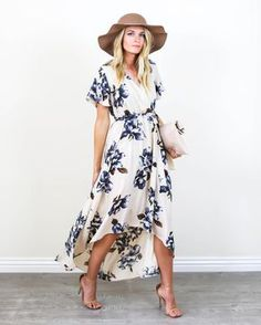Shipping now! Spring vibes have arrived and our Blue Bonnet Maxi Dress is perfection! A cream hued wrap dress with dark blue and brown florals. This soft and vintage inspired dress features a fitted e