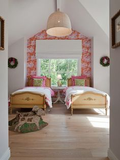 A fresh mix and dynamic wallpaper accent wall adds a jolt of bright color without overwhelming this girls' bedroom.