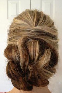 Similar twisting in the back as mine, but with all of the hair pulled up into a bun. Keeps the symmetry, but separates the bridesmaids' hair from the bride.