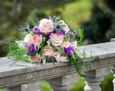 Pale pink and purple flower hand-tied bouquet