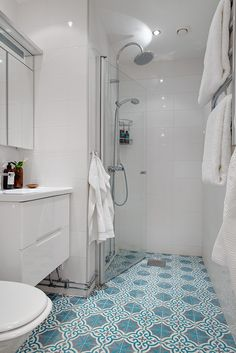 Moroccan floor tiles with simple white wall tiles